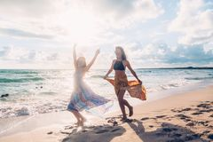 Boho girls walking on the beach Royalty Free Stock Photo