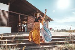 Boho girls walking on the beach Stock Image