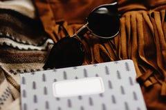 Boho gypsy stylish elements of jacket fringe sunglasses notebook. And camera, fashion set for travel stock photo