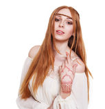 Boho hippie style young redhead woman isolated Royalty Free Stock Image