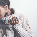 Boho jewelry and woolen sweater on model. Boho jewelry on model: ethnic stone rings and earrings. Beautiful woman wearing warm woolen sweater and fashion Royalty Free Stock Photography