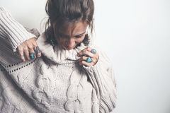 Boho jewelry and woolen sweater on model. Boho jewelry on model: ethnic stone rings and earrings. Beautiful woman wearing warm woolen sweater and fashion Royalty Free Stock Photos