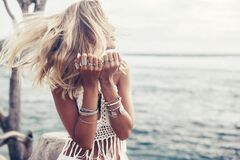 Free Boho Model Wearing Crochet Top And Silver Jewelry On The Beach Royalty Free Stock Images - 169797529