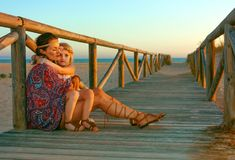 Boho Mother And Child Outdoors In Summer Evening Hugging Royalty Free Stock Image