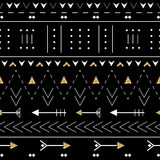Boho seamless pattern with decorative arrows. Ethnic geometric print with golden glitter texture. Stock Photo