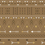 Boho seamless pattern with decorative arrows. Ethnic geometric print with golden glitter texture. Stock Images