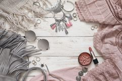 Boho style clothes and accessory. Boho style dusty pink and grey clothes and accessories on white vintage wooden background. Top view point stock images