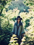 Boho style girl in the forest Stock Image