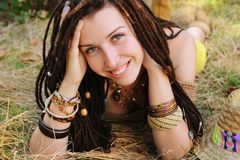 Boho style smiling woman portrait, girl have a fun lying outdoor in autumn sunny park stock photos