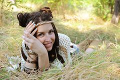 Boho style smiling woman portrait, girl have a fun lying outdoor in autumn sunny park stock photography