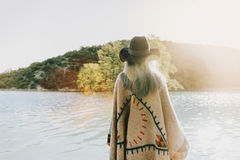 Boho style woman walking on lake Royalty Free Stock Images