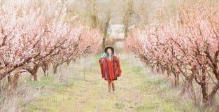 Boho style woman walking in spring garden. Royalty Free Stock Photo
