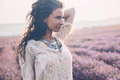 Boho styled model in lavender field stock photos