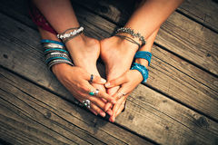 Boho summer bracelets anklets rings on girl feet and hands outdo Royalty Free Stock Photos