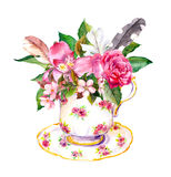 Boho tea cup with rose flowers and feathers. Watercolor