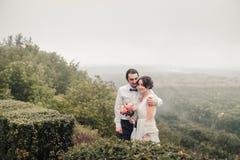 Boho wedding. beautiful couple kissing in park Royalty Free Stock Image