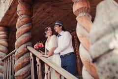 Boho wedding. beautiful couple kissing on wooden veranda Stock Image