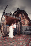 Boho wedding. beautiful couple kissing on wooden veranda Stock Photo