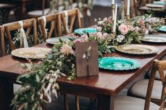 Boho wedding table for a newlywed banquet. Wedding table for a newlywed banquet with eco decor and floral design in the style of boho stock images