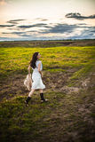 Boho woman in field Royalty Free Stock Photo