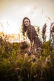Boho woman in field Stock Images