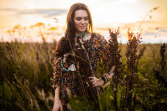 Boho woman in field royalty free stock photography