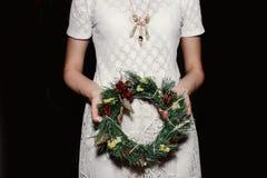 Boho woman holding christmas wreath in hands, seasonal holidays,. Rustic theme, adorning stock image