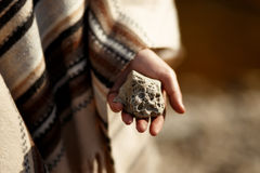 Boho woman holding in hand moon shaped textured stone at river b Stock Photo