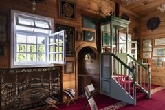 Wooden Tatar mosque interior in Bohoniki, Poland. BOHONIKI, POLAND -  MAY 03, 2018: Wooden tatar-mosque interior from the 18th century. The decorations and Royalty Free Stock Photos