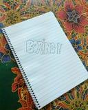 Bohrendes Skizzieren auf einem Notizblock Lizenzfreies Stockbild