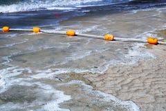 Boia amarelas na água Fotografia de Stock
