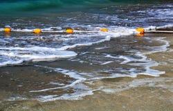 Boia amarelas na água Fotos de Stock