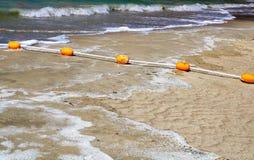 Boia amarelas na água Foto de Stock Royalty Free