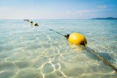 Boia amarelas no mar Foto de Stock Royalty Free
