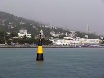 Boia do farol no mar fotografia de stock
