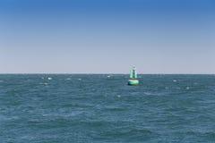 Boia do sinal no mar Fotos de Stock Royalty Free
