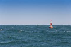 Boia do sinal no mar Fotos de Stock