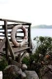 Boia e cais ao longo do beira-mar Imagem de Stock