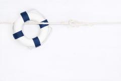 Boia salva-vidas azul no fundo branco Fotografia de Stock