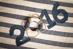 Boia salva-vidas em vez do dígito 0 no número 2016 no pano branco Fotografia de Stock Royalty Free