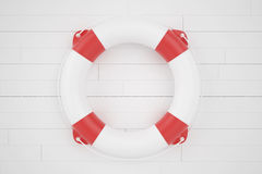 Boia salva-vidas que encontra-se em uma superfície de madeira Fotos de Stock
