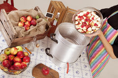 Boil apples. Make apple juice itself, on a table, many different apple varieties Stock Photo