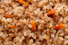 Boil buckwheat with carrot. Closeup detail background stock photo