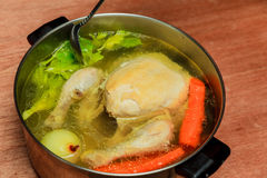 Boil chicken in the pot. Make chicken broth soup royalty free stock photography