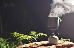Boil hike cook system. Cooking on camp stove in night stock photography
