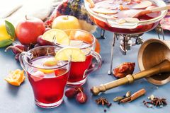 Boil mulled wine and punch. Glass jars with mulled wine. Spices, fruit. Hot wine for winter royalty free stock photography