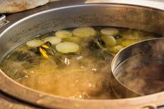 Boil a pot of soup. Stock Images