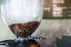 Boil vapor coffee beans in coffee machine Royalty Free Stock Photo