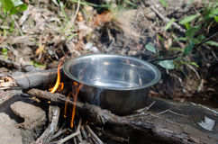 Boil water on the stove, firewood Wild coffee warm smell of smo. Ke and flame beautiful royalty free stock images