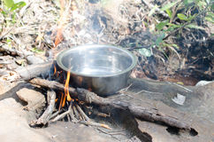 Boil water on the stove, firewood Wild coffee warm smell of smo. Ke and flame beautiful royalty free stock photo